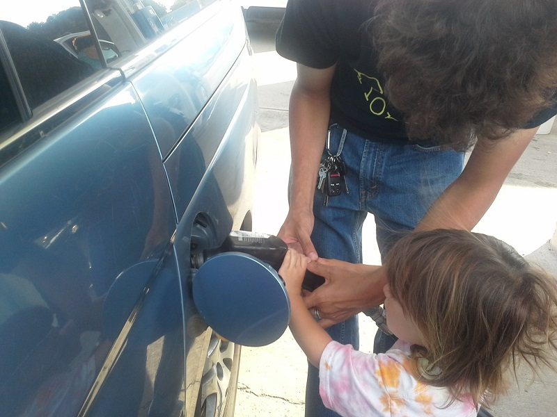 Family Pumping Gasoline