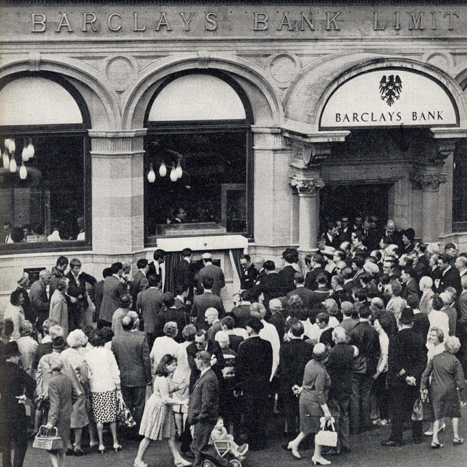 People scramble to get a look at the world's first ATM. Credit: PA Archive