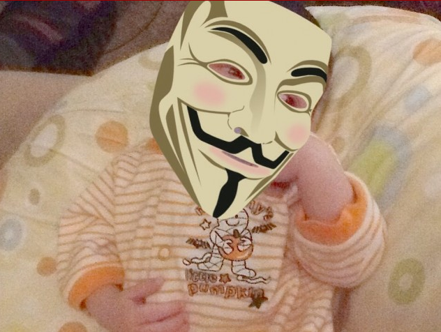 Baby Neo – privacy protected with Guy Fawkes mask courtesy of his parents